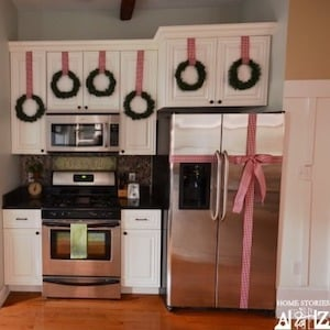 Christmas Wreaths on cabinet and Bow on Refrigerator