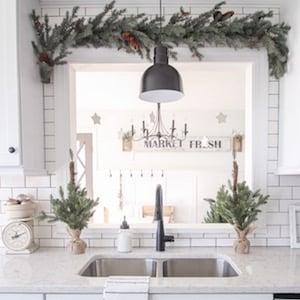 Snowflake & Greenery Kitchen Window Decor Idea