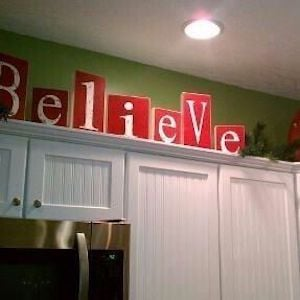 Believe Sign Above Kitchen Cabinet Christmas Kitchen Decor