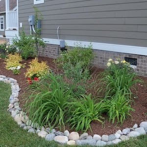 garden bed edging with river rocks