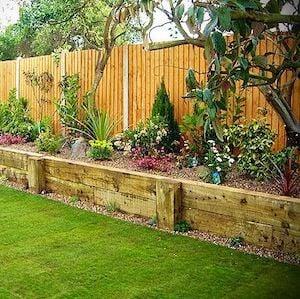 backyard raised planter along fence