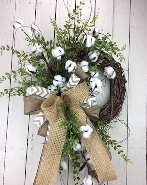 Farmhouse Cotton Wreath with greenery and a burlap bow