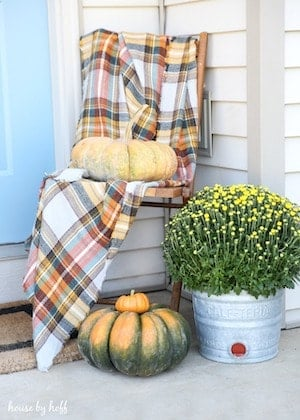 fall front stoop with plaid blanket mums and pumpkins