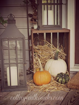 Rustic Fall Front Porch with crate, hay, lantern and pumpkins