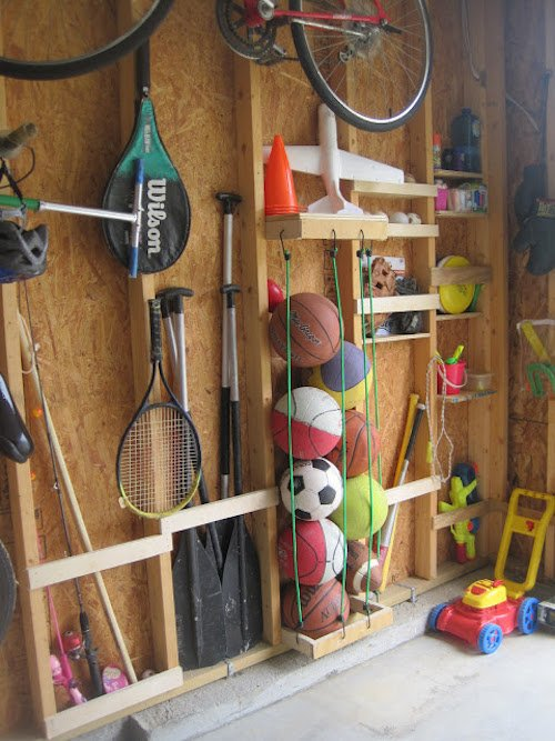 Using studs to organize the garage wall