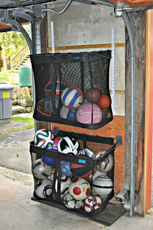 outdoor Ball organizer using mesh laundry baskets hung in the garage