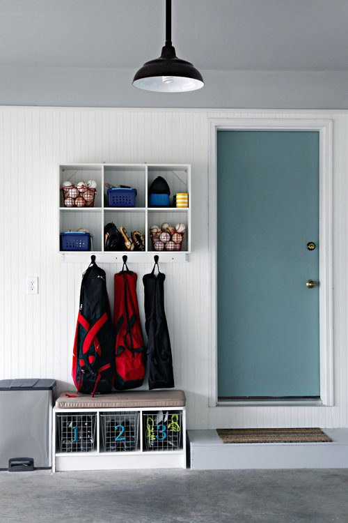 garage mudroom organization with wall mounted shelving