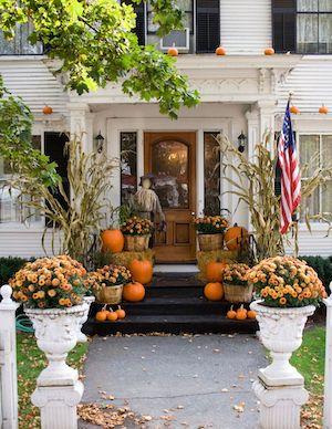 Orange Pumpkins and orange mums on front stairs