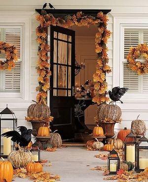 Halloween Porch with fall door garland, grapevine pumpkins and lanterns