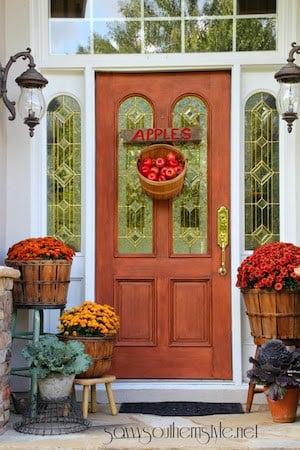 apple bushel door basket with mums next to the door