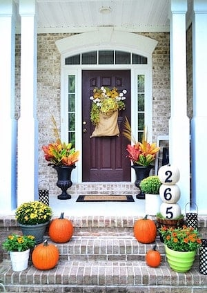 orange and green bright front porch steps and door