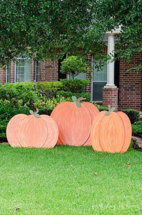 wooden pumpkins in yard