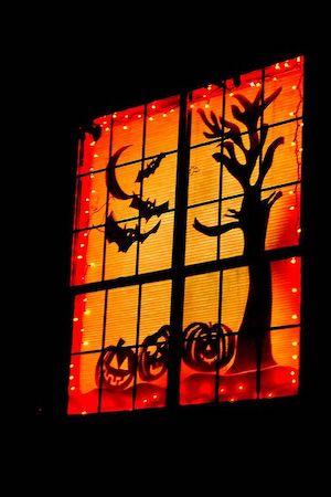 orange and black lit up window decoration for halloween