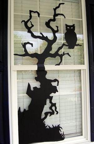 Halloween window decor using black vinyl and clipart