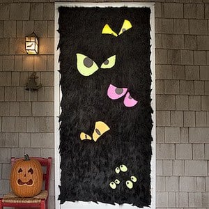 furry black front door with scary eyes