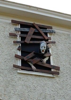 zombie breaking out of window decor