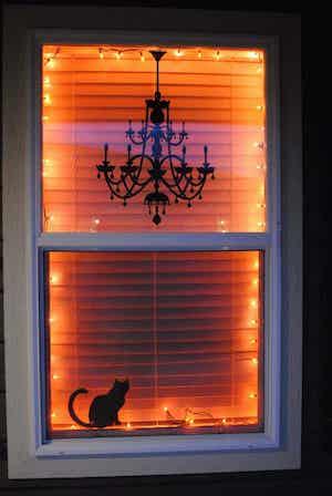 spooky halloween window with orange string lights