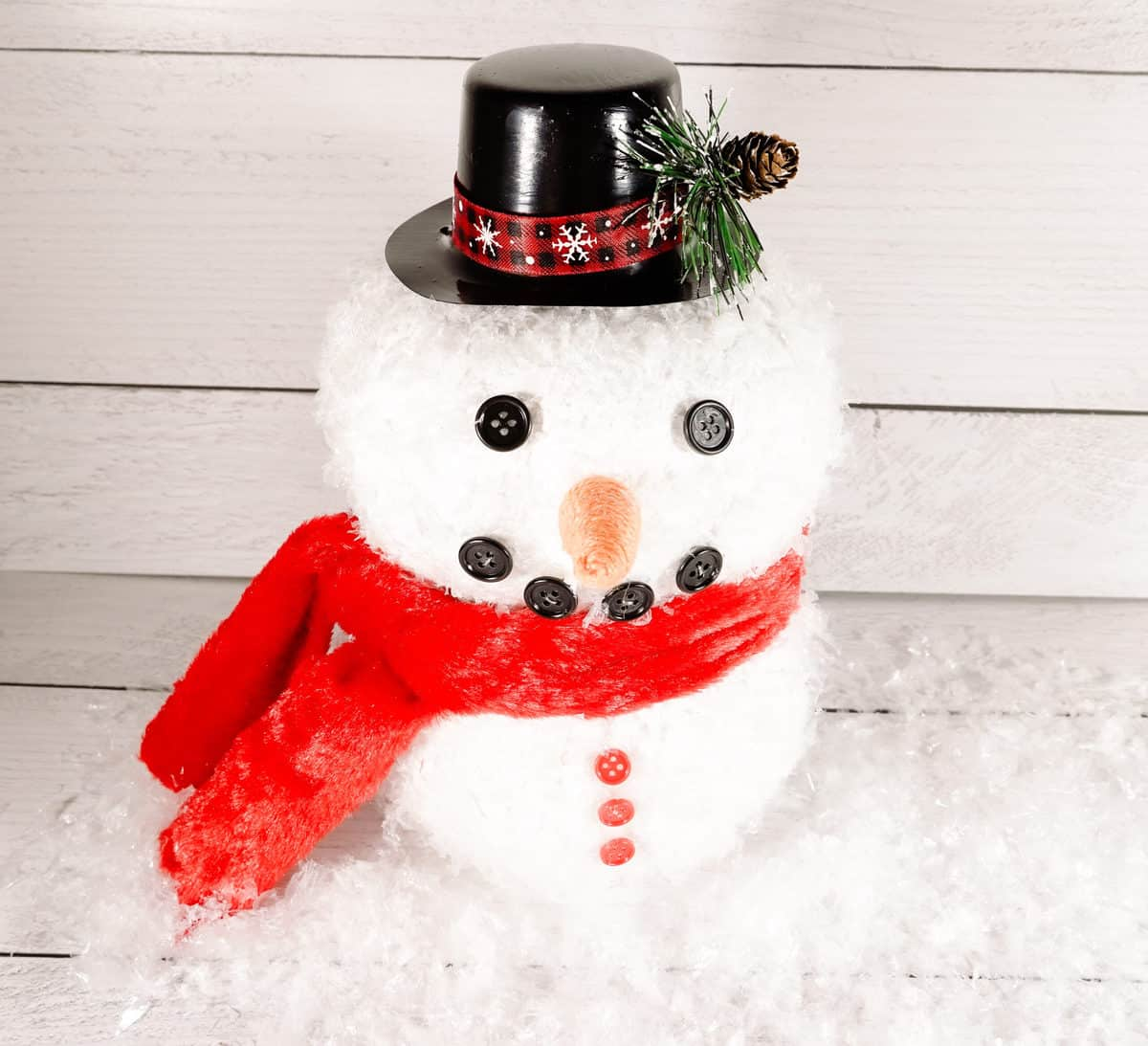 horizontal image of snowman decoration in top hat and scarf