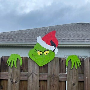grinch peaking over fence christmas decoration for outside