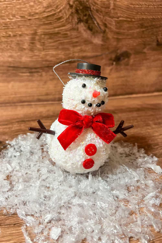 DIY snowman ornament on top of a snow